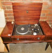 A Dynatron SRX80 record player, in a mahogany finish cabinet, the central lift up section with