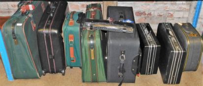 Various suitcases, material cases, ties, and two Potterton cases. (9)