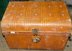 A tin trunk, with a domed top and padlock.