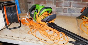 An electric hedge trimmer, 550w, serial number PWR550HTA.