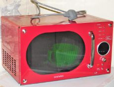 A Daewood microwave, in red, 800w.
