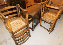 An Old Charm oak finish extending drop leaf dining table and set of four chairs, the dining table