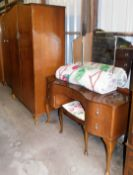A mid 20thC walnut finish bedroom suite, comprising two wardrobes, bedside table and a dressing