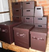 A large group of faux leather storage trays and boxes, to include a graduated set of three storage