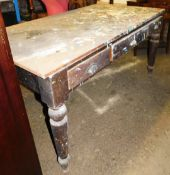 A Victorian pine kitchen table, with three drawers on tapered legs, the top with various paint