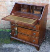 A reproduction mahogany bureau, with fitted interior, above four drawers, 96cm high, 78cm wide, 48cm