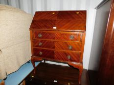 A 20thC mahogany bureau, with fitted interior raised on cabriole legs, 100cm high, 78cm wide, 41cm