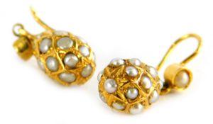 A pair of seed pearl bead earrings, each with drop bead Eastern design, in yellow metal frame,