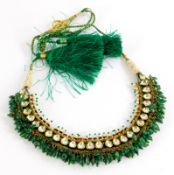 An Indian dress necklace, made up of various rectangular enamelled panels, the front set with seed