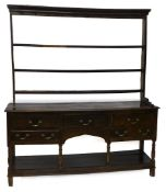 A late 18th/early 19thC oak dresser, the associated raised back with three plate shelves, the base
