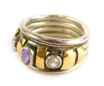 A dress ring, set with oval cut amethyst and two round brilliant cut diamonds, with yellow gold