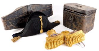 A Naval bicorn hat, with a fitted toleware case, and a pair of Epaulettes in toleware box stamped H.