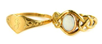 Two dress rings, to include a 9ct gold opal set dress ring, with weave design shoulders, ring size