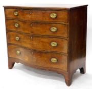 A George III mahogany and boxwood strung serpentine fronted chest, the top with a crossbanded