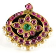 An Indian design dress ring, converted from an oval pendant set with rough cut rubies and