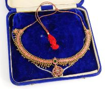 An Indian dress necklace, the necklace set with cabochon set rubies, with emerald and moon stone