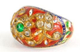 An Indian enamel and gem set ring, the ring set with central cabochon green emerald, in a floral