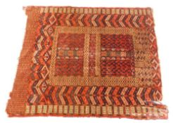 A Turkoman type rug, with a geometric design in navy blue, red, etc., on a red ground with