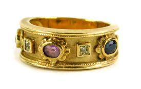 A Brooks and Bentley amethyst and diamond 9ct gold dress ring, of Eastern design with central