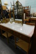 A mahogany pine and glass rectangular dressing table, with fabric top and a gilt triple mirror. (2)