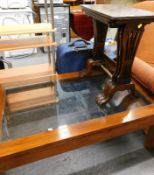 A nest of three mahogany tables, and a hardwood glass coffee table.