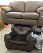 A two seater brown leatherette sofa, and a similar arm chair. The upholstery in this lot does not