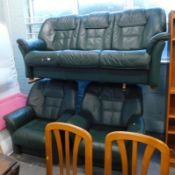 A green leather three seat sofa, and two matching armchairs, stamped BD.