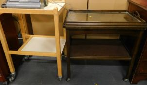 A walnut veneered tray top two tier trolley, and another trolley. (2)