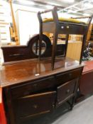 An oak sideboard with mirror back and two doors, and a piano stool. (2)