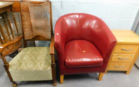 A caned back armchair, a red leatherette tub chair, and a modern oak chest of three drawers.