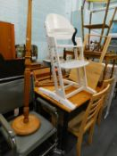 A pine kitchen table, three chairs, standard lamp, child's high chair, coffee table, bamboo table,