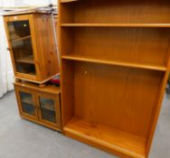 A pine HIFI cabinet, an oak veneered TV cabinet and a teak bookcase, walking sticks, oval coffee