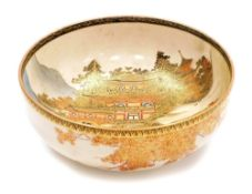 A Japanese Satsuma bowl, decorated with women walking in front of The Golden Pavilion in Kyoto,