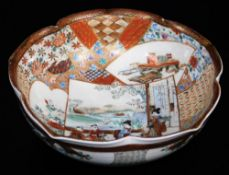 A Japanese lobed Satsuma bowl, decorated with overlapping shaped panels depicting women and children