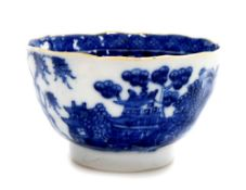 A Chinese export porcelain blue and white tea bowl, decorated with buildings, birds and trees with
