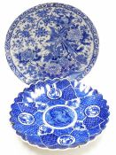 A Japanese Meiji style pottery plate, transfer printed with exotic birds and flowers, 31cm diameter,