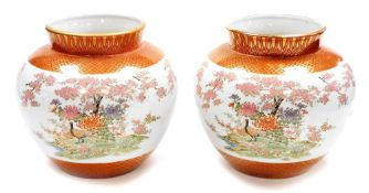 A pair of Japanese Kutani porcelain jardinieres, decorated with pheasants chrysanthemums and