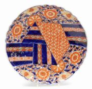 A 19thC Imari dish, of floral circular form, profusely decorated with flowers and a geometric