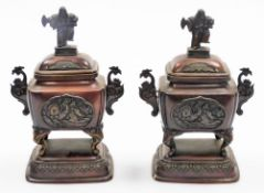 A pair of Japanese bronze incense burners, each with domed lids with Sambaso dancer knops, the