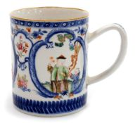 A Chinese export porcelain mug, decorated with blue cartouches containing coloured enamelled