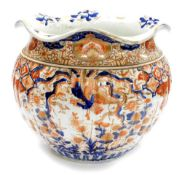A large Japanese Imari Meiji period jardiniere, the flared rim above a ribbed circular body,