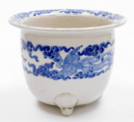 A Japanese porcelain jardiniere, the rim decorated with flowers, the body with a band of ho-o