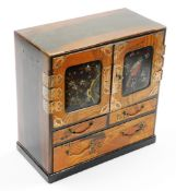 A Japanese Meiji period parquetry and lacquer table cabinet, with two doors opening to reveal six
