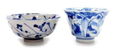 A Chinese porcelain tea bowl, decorated with lappets filled with figural and landscape decoration
