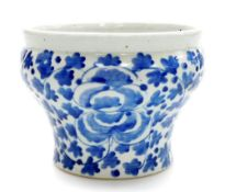 A late 19thC Chinese blue and white jardiniere, of waisted form painted with flowers and leaves,