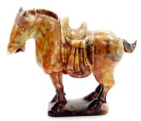 A Chinese soapstone Tang style figure of a standing saddled horse, on shaped base, 20cm high.