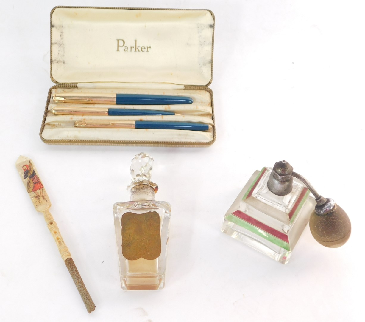 A Parker three piece writing set, in green and 12ct rolled gold, comprising a 51 fountain pen, a