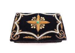 A lady's black velvet evening bag, with wire work and bead work floral decoration, 17cm wide.