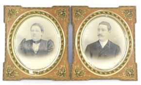 A pair of Belgian late 19thC photographic portraits, a study of a gentleman and lady, in gilt