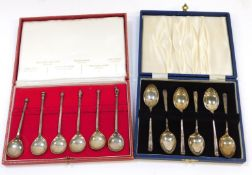 A set of six replica knop and seal top coffee spoons, cased, London 1968, and a further set of six